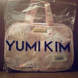 Yumi Kim makeup train case